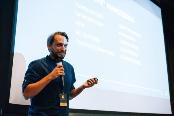 Bartek speaking at the conference