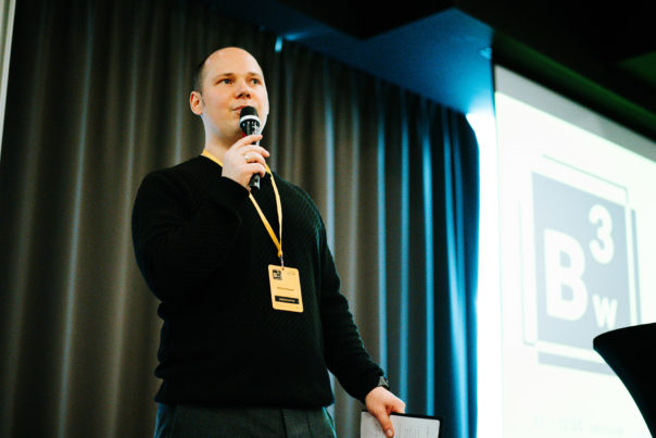 Michal speaking at the conference